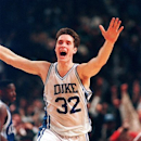 FILE - In this March 28, 1992 file photo, Duke's Christian Laettner runs down the court after making the last second, game-winning shot to defeat Kentucky 104-103 in overtime of the East Regional Final of the NCAA college basketball tournament in Philadelphia. (AP Photo/Amy Sancetta, File)