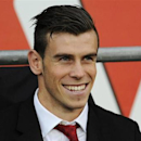 Wales' Gareth Bale sits on the touchline during their international friendly soccer match against Ireland at the Cardiff City Stadium, in Cardiff August 14, 2013. REUTERS/Rebecca Naden