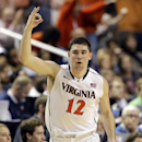 Virginia's Joe Harris celebrates after making a 3-point basket against Duke during the second half of an NCAA college basketball game in the championship of the Atlantic Coast Conference tournament in Greensboro, N.C., Sunday, March 16, 2014. (AP Photo/Gerry Broome)