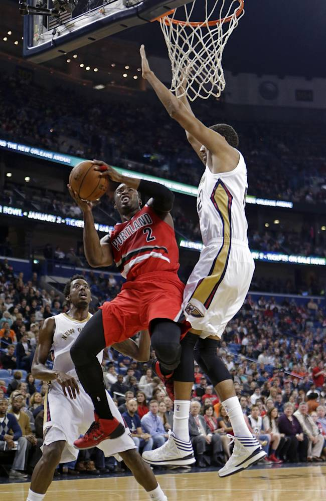 Portland Trail Blazers guard Wesley Matthews (2) drives to the basket against New Orleans Pelicans center Alexis Ajinca in the first half of an NBA basketball game in New Orleans, Monday, Dec. 30, 2013