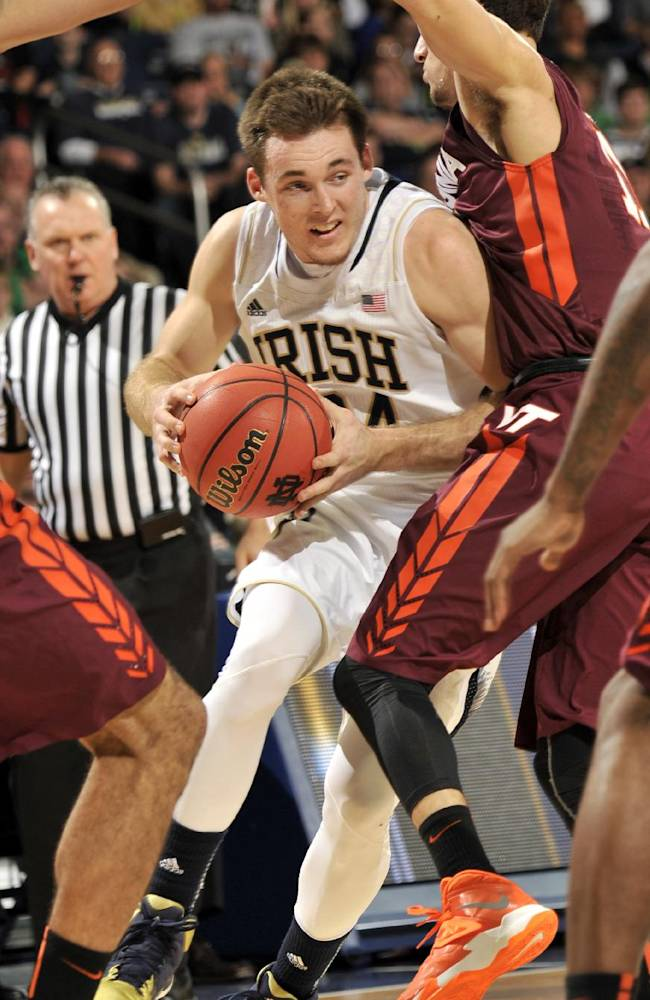 Notre Dame guard Pat Connaughton drives between Virginia Tech players during the second half of an NCAA college basketball game, Sunday, Jan. 19, 2014 in South Bend, Ind. Notre Dame won 70-63 with Connaughton leading all scorers with 21 points