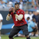 Carolina Panthers' Cam Newton runs through a drill during an NFL football practice at the team's Fan Fest in Charlotte, N.C., Friday, July 25, 2014. (AP Photo)