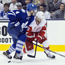 Toronto Maple Leafs' Cody Franson (4) battles for the puck with Detroit Red Wings' Henrik Zetterberg (40) during third period of an NHL hockey game in Toronto, Saturday, Dec. 13, 2014 The Associated Press