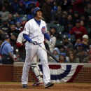 Chicago Cubs' Ryan Sweeney (6) reacts after striking out during the seventh inning of a baseball game against the Philadelphia Phillies on Friday, April 4, 2014, in Chicago The Associated Press