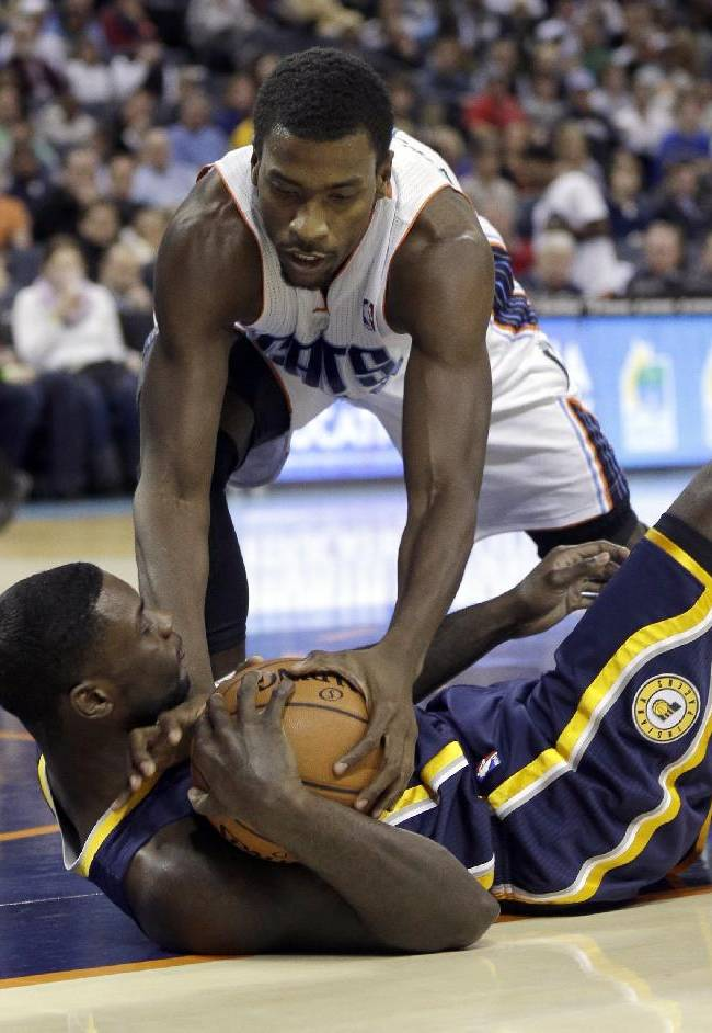 Charlotte Bobcats' Michael Kidd-Gilchrist, top, tries to steal the ball from Indiana Pacers' Lance Stephenson, bottom, during the first half of an NBA basketball game in Charlotte, N.C., Wednesday, Nov. 27, 2013