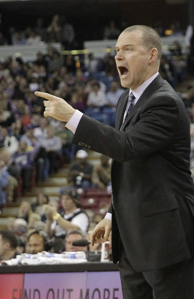 Sacramento Kings head coach Michael Malone yells about a foul call during the fourth quarter of the Kings 108-97 loss to the Minnesota Timberwolves in a NBA basketball game in Sacramento, Calif., Saturday, March 1, 2014