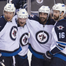 Winnipeg Jets center Bryan Little (18) celebrates his goal with teammates, from left, Blake Wheeler, Mathieu Perreault (85) and Andrew Ladd during the third period of an NHL hockey game against the Vancouver Canucks on Tuesday, Feb. 3, 2015, in Vancouver,