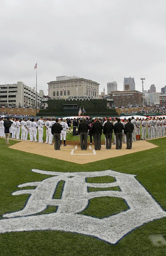 Umpires line up in missing-man formation for Bell