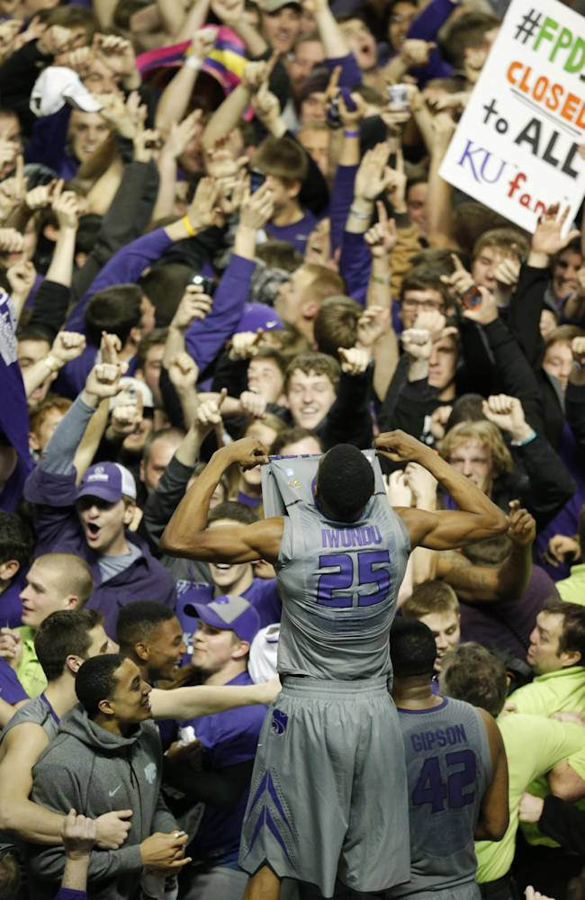 Kansas State guard Wesley Iwundu (25) celebrates with fans following an NCAA college basketball game against Kansas in Manhattan, Kan., Monday, Feb. 10, 2014. Kansas State defeated Kansas 85-82 in overtime