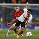 Donetsk's Douglas Costa, right, gets away from Manchester United's Alexander Buttner during their Champions League group A soccer match between Manchester United and Shakhtar Donetsk at Old Trafford Stadium, Manchester, England, Tuesday, Dec. 10, 2013