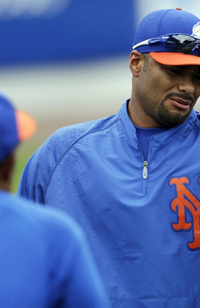 In this March 1, 2013, photo, New York Mets pitcher Johan Santana, right, talks to bullpen coach Ricky Bones before the Mets' spring training baseball game against the Detroit Tigers in Port St. Lucie, Fla. The Mets have declined a $25 million option on the injured pitcher on Friday, Nov. 1, 2013, and will pay the left-hander a $5.5 million buyout. Santana will be 35 next season and becomes a free agent