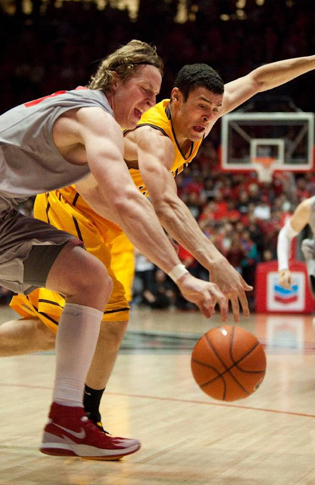New Mexico's Cameron Bairstow, left, battles Wyoming's Larry Nance Jr. for a loose ball in the second half of an NCAA college basketball game Wednesday, Feb. 5, 2014 in Albuquerque, N.M. New Mexico won in overtime 66-61
