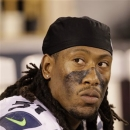 FILE- In this Oct. 18, 2012, file photo, Seattle Seahawks defensive end Bruce Irvin watches from the sideline during the fourth quarter of an NFL football game against the San Francisco 49ers in San Francisco. Irvin has been suspended for the first four games of the 2013 season after the league announced he violated the NFL policy on performance-enhancing substances, the NFL announced Friday,May 17, 2013. (AP Photo/Ben Margot, File)