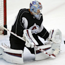 Colorado Avalanche goalie Semyon Varlamov makes a save during the first day of NHL hockey training camp Friday, Sept. 19, 2014, in Centennial, Colo The Associated Press
