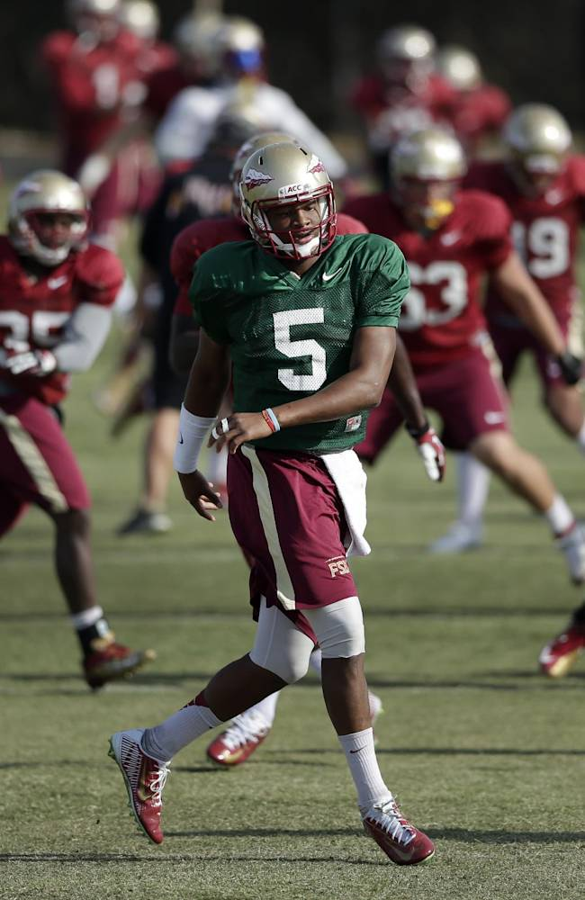 Florida State quarterback Jameis Winston (5) warms up with teammates during practice Friday, Jan. 3, 2014, in Costa Mesa, Calif. Top-ranked Florida State faces No. 2 Auburn in the BCS championship game college football game Monday in Pasadena, Calif