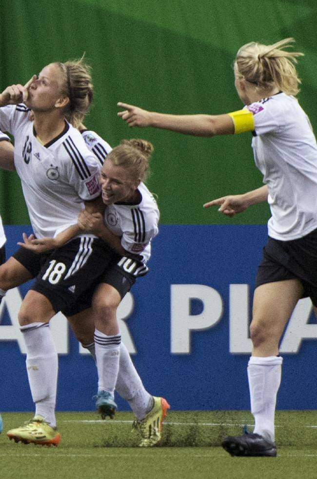 Germany's Lena Petermann (18) celebrates her goal against France with teammates during the second half of a FIFA U-20 women's World Cup semifinal in Montreal on Wednesday, Aug. 20, 2014. Germany won 2-1