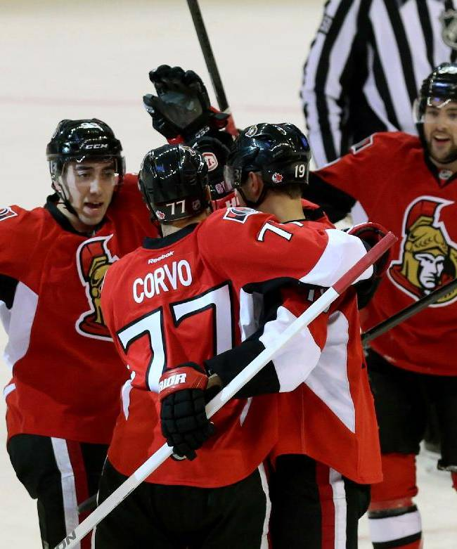 Ottawa Senators Joe Corvo (77) celebrates his goal against the Los Angeles Kings with teammates Jason Spezza (19) and Mika Zibanejad (93) and Cory Conacher (89) during second period of an NHL hockey game in Ottawa, Ontario, Saturday, Dec. 14, 2013
