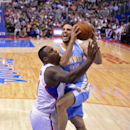 Denver Nuggets guard Evan Fournier, right, goes up for a shot as Los Angeles Clippers forward Glen Davis defends during the first half of an NBA basketball game, Tuesday, April 15, 2014, in Los Angeles The Associated Press