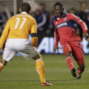 Chicago Fire midfielder Patrick Nyarko (14) passes the ball against Houston Dynamo midfielder Brad Davis (11) during the second half of an MLS soccer playoffs on Wednesday, Oct. 31, in Bridgeview, Ill. The Dynamo won 2-1. (AP Photo/Nam Y. Huh)