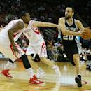 HOUSTON, TX - OCTOBER 24:  Manu Ginobili #20 of the San Antonio Spurs dtrives with the ball against Joey Dorsey #8 of the Houston Rockets during their preseason game at Toyota Center on October 24, 2014 in Houston, Texas NOTE TO USER: User expressly acknowledges and agrees that, by downloading and/or using this photograph, user is consenting to the terms and conditions of the Getty Images License Agreement. Mandatory copyright notice:  (Photo by Scott Halleran/Getty Images)