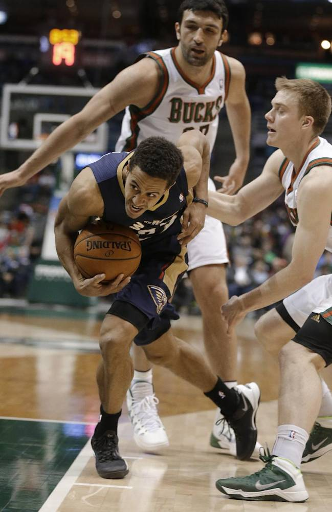 New Orleans Pelicans' Brian Roberts, left, drives against Milwaukee Bucks' Nate Wolters, right, during the second half of an NBA basketball game Wednesday, Feb. 12, 2014, in Milwaukee