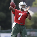 New York Jets quarterback Geno Smith (7) throws a pass at practice during NFL football training camp Friday, July 25, 2014, in Cortland, N.Y. (AP Photo) The Associated Press
