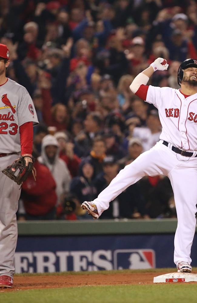 Boston Red Sox's Shane Victorino, right, reacts after driving in three runs with a double in the third inning during Game 6 of the World Series against the St. Louis Cardinals, Wednesday, Oct. 30, 2013, at Fenway Park in Boston. Cardinals third baseman David Freese, left, looks on. The Red Sox won 6-1 to win the series