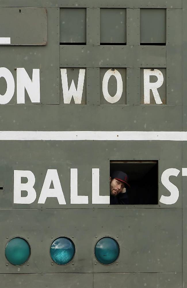 St. Louis Cardinals' Lance Lynn looks out of a scoreboard under the Green Monster before batting practice for Game 1 of baseball's World Series against the Boston Red Sox Tuesday, Oct. 22, 2013, in Boston