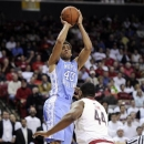 North Carolina forward James Michael McAdoo (43) shoots over Maryland center Shaquille Cleare (44) during the first half of an NCAA college basketball game, Wednesday, March 6, 2013, in College Park, Md. (AP Photo/Nick Wass)