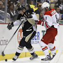 Pittsburgh Penguins' Beau Bennett (19) and Carolina Hurricanes' Andrei Loktionov (8), of Russia, battle along the boards during the second period of an NHL hockey game onTuesday, April 1, 2014, in Pittsburgh The Associated Press