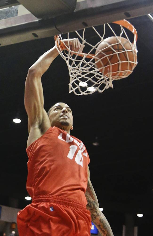 New Mexico guard Kendall Williams dunks against San Diego State  during the second half of a NCAA college basketball game Saturday, March 8, 2014, in San Diego. New Mexico built a 14 point lead only to lose 51-48 and San Diego State captured the Mountain West Conference regular season championship