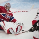 Montreal Canadiens goaltender Carey Price makes a save against Ottawa Senators Mika Zibanejad (93) during the second period of an NHL preseason hockey game Saturday, Oct. 4, 2014, in Montreal The Associated Press