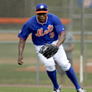 New York Mets outfielder Curtis Granderson chases a grounder during spring training baseball practice Saturday, Feb. 22, 2014, in Port St. Lucie, Fla The Associated Press