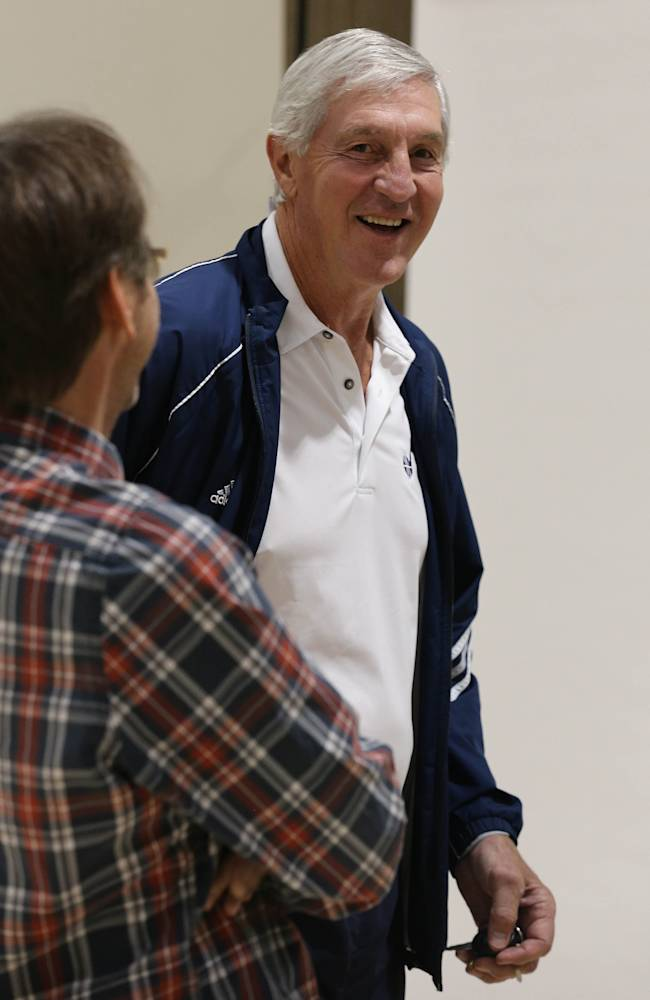 Former Utah Jazz head coach and current senior basketball advisor Jerry Sloan jokes with a photographer at the NBA's basketball teams media day in Salt Lake City, Friday, Sept. 30, 2013