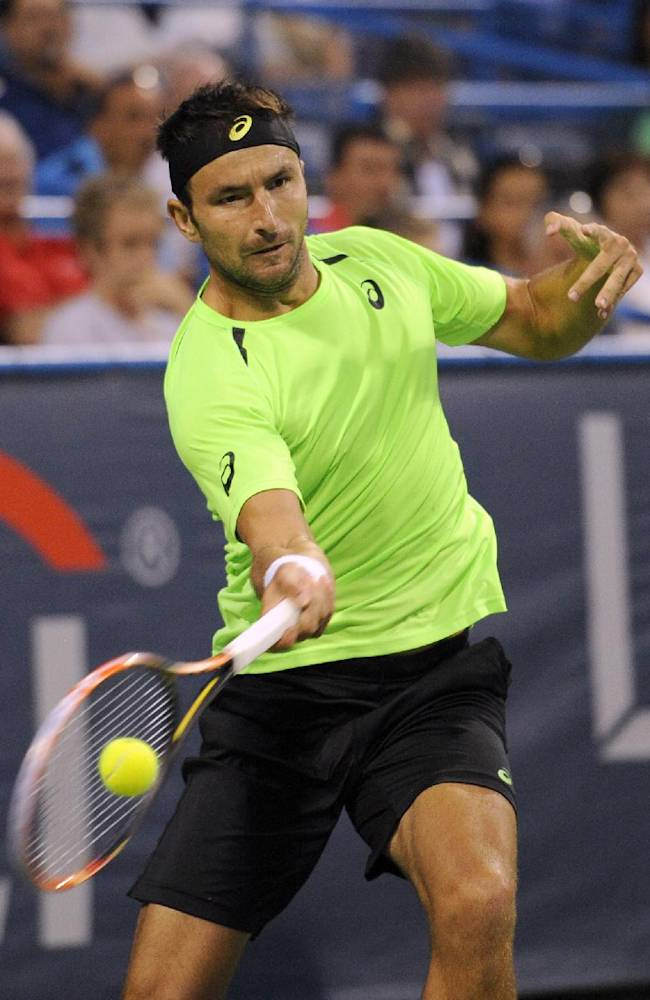 Marinko Matosevic, of Australia, returns the ball against Lleyton Hewitt, of Australia, during a match at the Citi Open tennis tournament, Tuesday, July 29, 2014, in Washington