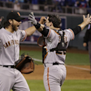 San Francisco Giants pitcher Madison Bumgarner, left, and Buster Posey celebrate after winning 3-2 to win the series over Kansas City Royals after Game 7 of baseball's World Series Wednesday, Oct. 29, 2014, in Kansas City, Mo The Associated Press