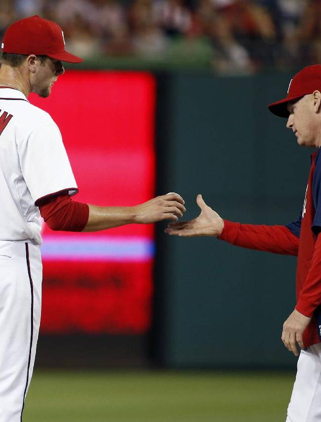 Washington Nationals pitcher Blake Treinen (64) is relieved by manager Matt Williams during the sixth inning of a baseball game against the Los Angeles Dodgers at Nationals Park, Tuesday, May 6, 2014, in Washington