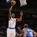 New York Knicks' Amar'e Stoudemire (1) shoots over Philadelphia 76ers' James Anderson (9) during the first half of an NBA basketball game Monday, March 10, 2014, in New York The Associated Press
