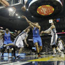 Oklahoma City Thunder's Steven Adams (12), of New Zealand, shoots over Memphis Grizzlies' Kosta Koufos (41) in the first half of an NBA basketball game in Memphis, Tenn., Wednesday, Dec. 11, 2013. (AP Photo/Danny Johnston)