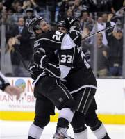 Los Angeles Kings center Jarret Stoll, left, celebrates his goal with defenseman Willie Mitchell during the second period of their NHL hockey game against the San Jose Sharks, Thursday, April 5, 2012, in Los Angeles. (AP Photo/Mark J. Terrill)