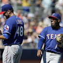 Texas Rangers' Elvis Andrus, right, talks with starting pitcher Colby Lewis during the first inning of an exhibition spring training baseball game against the Seattle Mariners, Sunday, March 9, 2014, in Peoria, Ariz The Associated Press