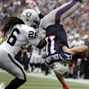 Oakland Raiders strong safety Usama Young (26) upends New England Patriots wide receiver Julian Edelman (11) after a catch in the second half of an NFL football game Sunday, Sept. 21, 2014, in Foxborough, Mass The Associated Press