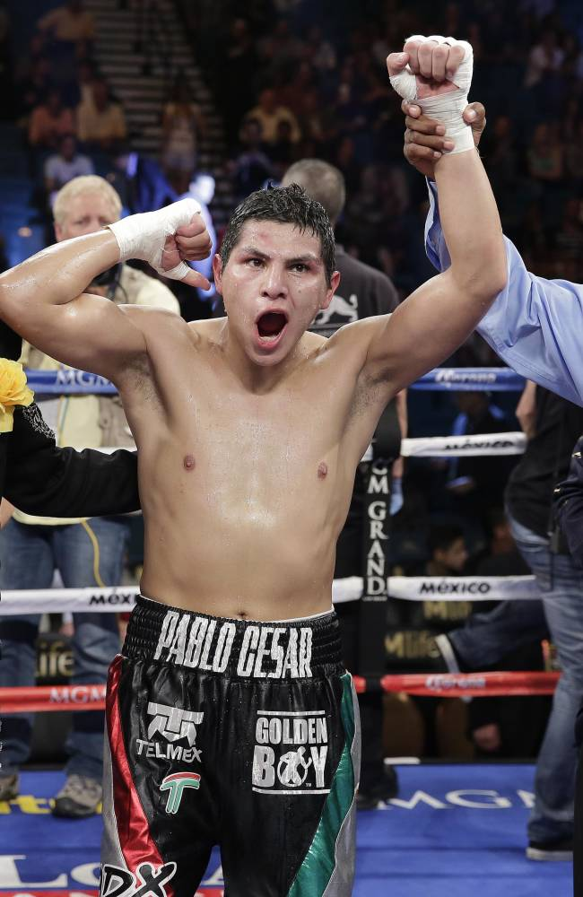 Pablo Cesar Cano reacts as he is declared the winner over Ashley Theophane in a welterweight fight, Saturday, Sept. 14, 2013, in Las Vegas