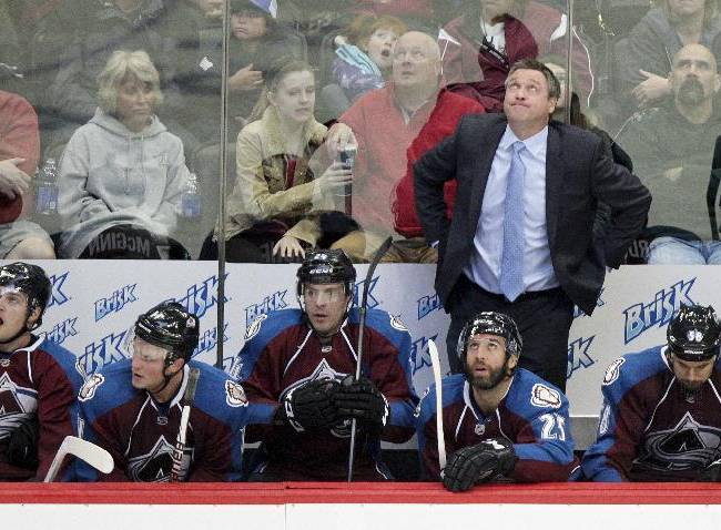 Colorado Avalanche head coach Patrick Roy shows signs of concern as the clock ticks away during the third period of an NHL hockey game against the Nashville Predators on Wednesday, Nov. 6, 2013 in Denver. The Predators won 6-4