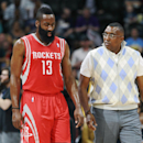 Houston Rockets guard James Harden, left, walks back to bench after hurting his left leg, next to trainer Keith Jones in the third quarter of the Denver Nuggets' 123-116 victory in an NBA basketball game in Denver on Wednesday, April 9, 2014 The Associate