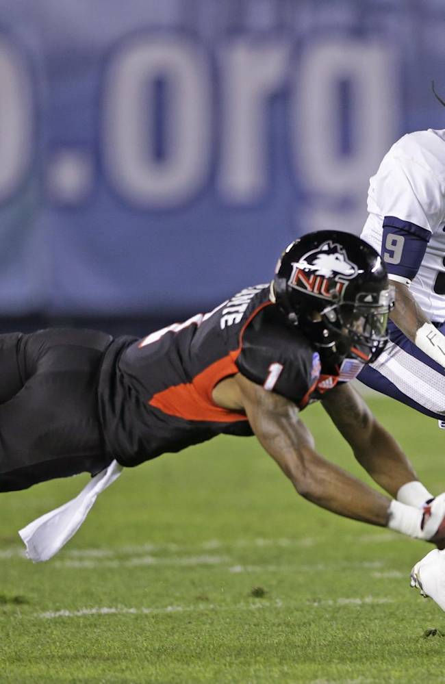 Northern Illinois safety Dechane Durante, front, breaks up a pass intended for Utah State receiver Bruce Natson during the first half of the Poinsettia Bowl NCAA college football game  Thursday, Dec. 26, 2013, in San Diego