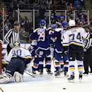 New York Islanders center Frans Nielsen (51), center Brock Nelson (29) and teammates celebrate center John Tavares's (91) goal as St. Louis Blues goalie Martin Brodeur (30) and right wing T.J. Oshie (74) react in the second period of an NHL hockey game at