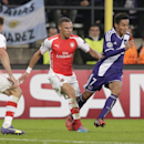 Arsenal's Kieran Gibbs, centre, challenges Anderlecht's Andy Najar for the ball during the Group D Champions League match between Anderlecht and Arsenal at Constant Vanden Stock Stadium in Brussels, Belgium, Wednesday Oct. 22, 2014