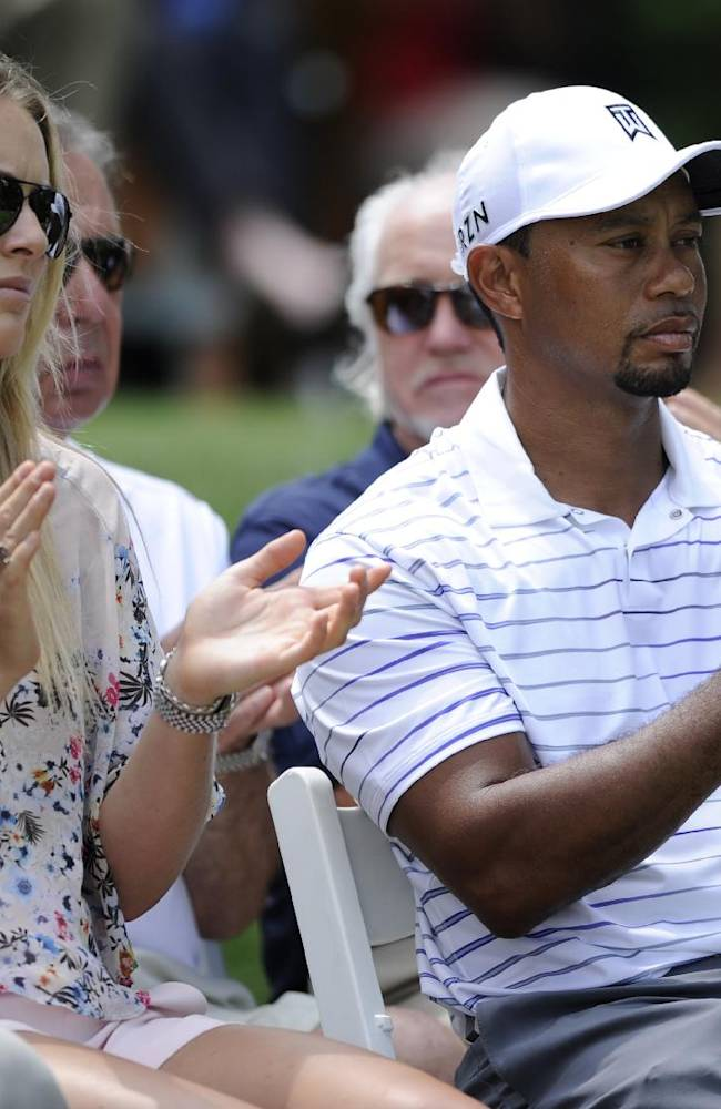 Tiger Woods, right, and his girlfriend Lindsey Vonn, left, react during the opening ceremony at the Quicken Loans National golf tournament, Wednesday, June 25, 2014, in Bethesda, Md