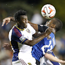 Real Salt Lake defender Abdoulie Mansally, left, vies for a header against San Jose Earthquakes midfielder Atiba Harris (23) during the second half of an MLS soccer match Saturday, Aug. 30, 2014, in Santa Clara, Calif. The game ended in a 1-1 tie The Asso